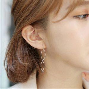 Curvy gold / silver earrings drop